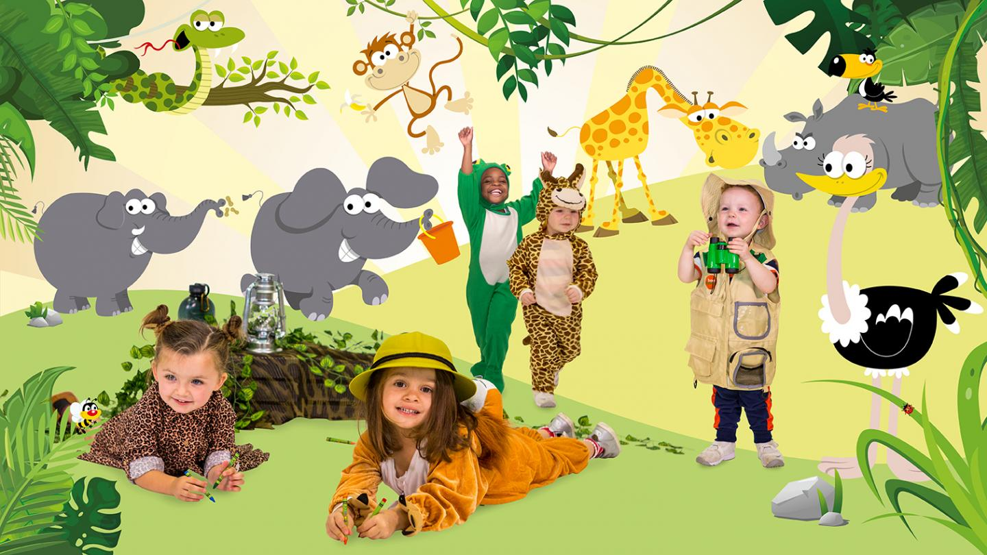 young children in animal costumes against safari backdrop