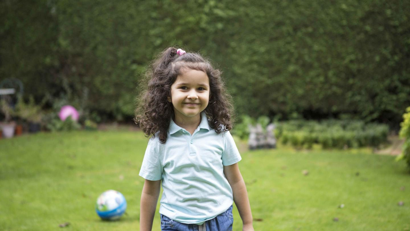 Young girl in garden smiling