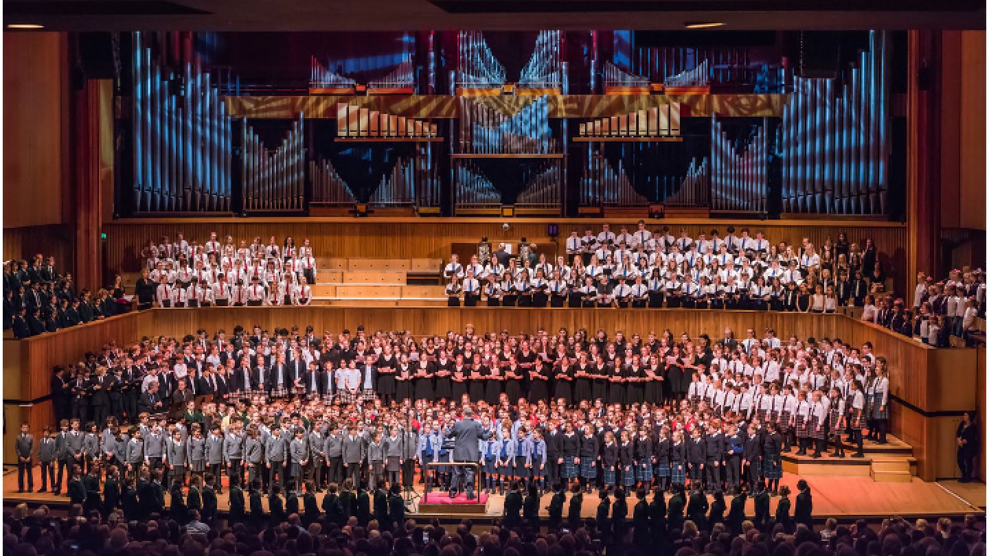 Large youth choir performing on stage at the Royal Festival Hall