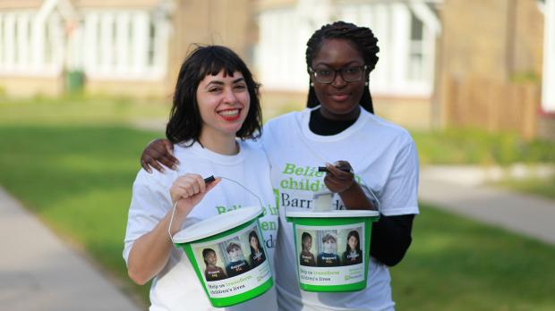 Two Barnardo's fundraisers with buckets