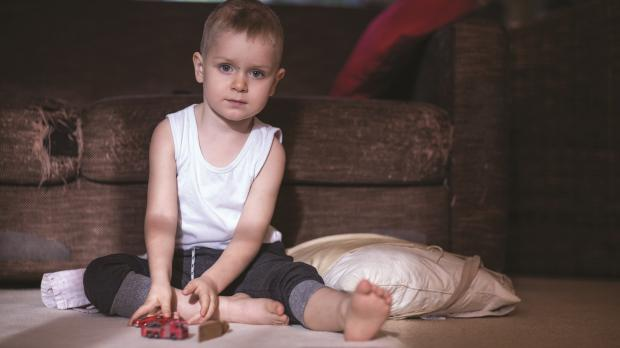 Boy sitting on floor with toy