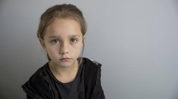 Girl looking sadly at camera