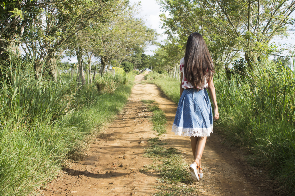 Young girl walking down a country lane