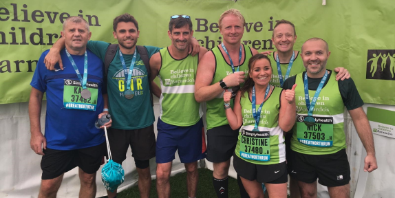 Group of smiling people who have finished a marathon