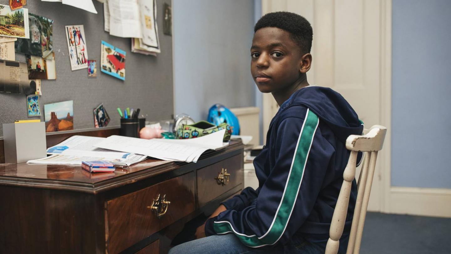 Young boy sitting at desk