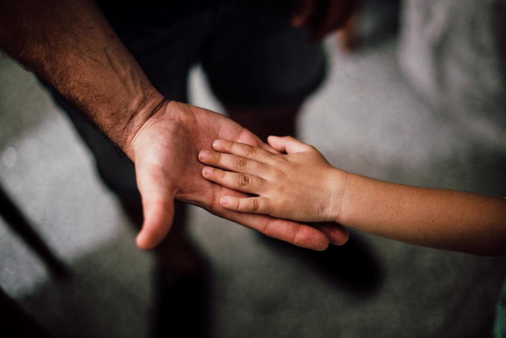 Parent holding childs hand