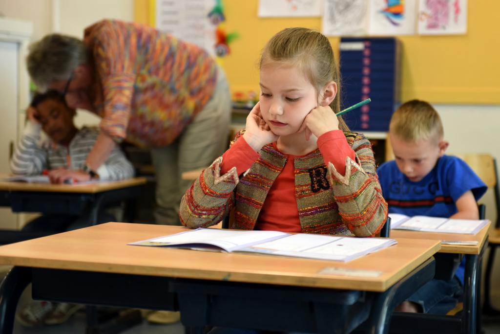 Schoolgirl sitting at her desk