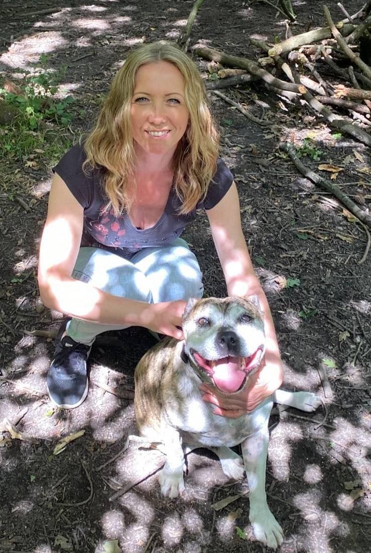 Woman crouching down with dog
