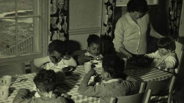 Children eating dinner at Oakley House
