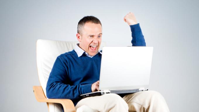 Man celebrating on laptop