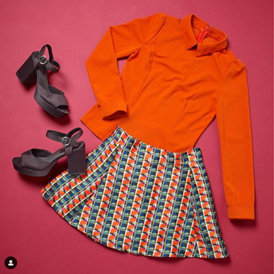orange blouse, skirt and heels from a charity shop