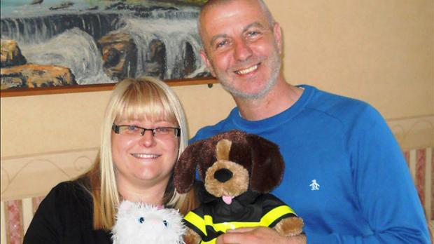 Two foster carers posing with teddy bears