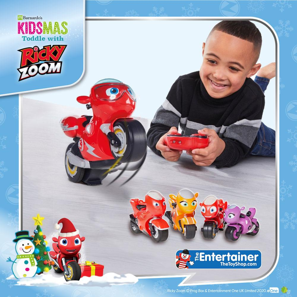 Young boy playing with remote control cars