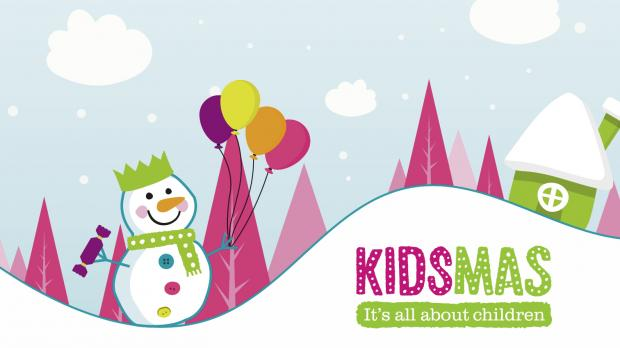 Cartoon Kidsmas snowman on a snowy background, with the words Kidsmas, It's all about children in the corner