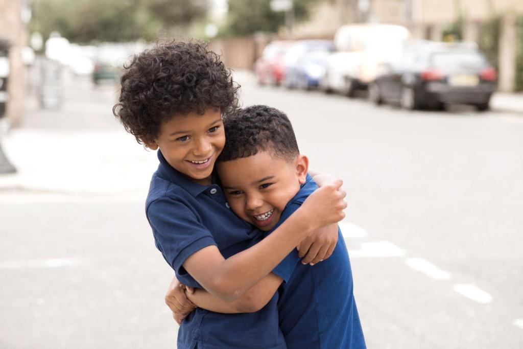Two young boys smiling and hugging