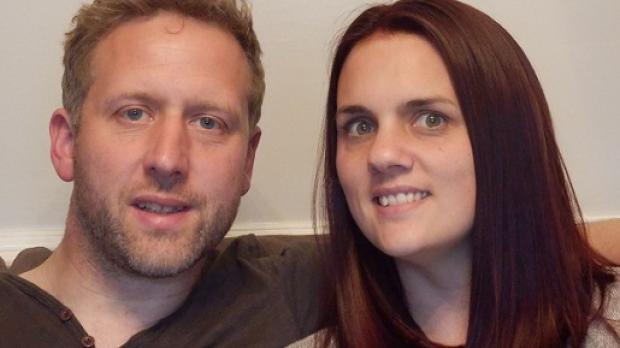 Close up of a smiling adoptive couple