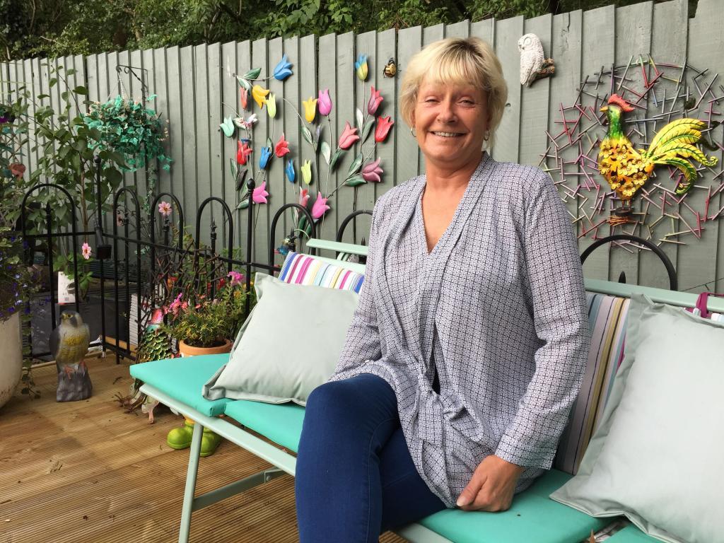 Woman sitting on garden bench