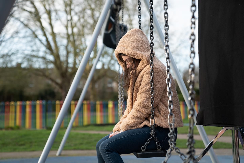 Teen girl on swing set
