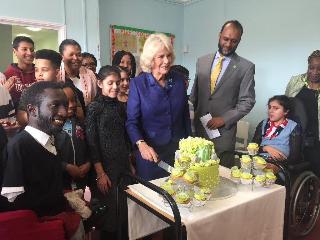 Her Royal Highness, The Duchess of Cornwall, cuts a cake baked by Zhane Decembre