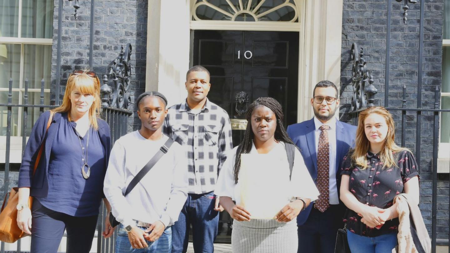 A group of young people outside 10 Downing Street