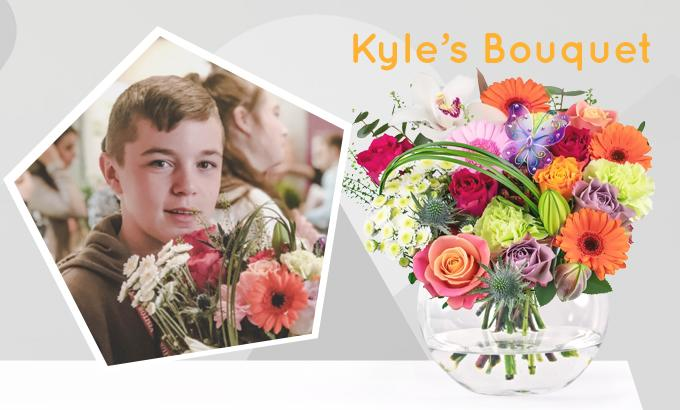 Young boy with bouquet of flowers