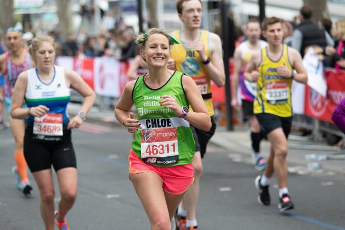 Marathon runner in a green Barnardo's vest