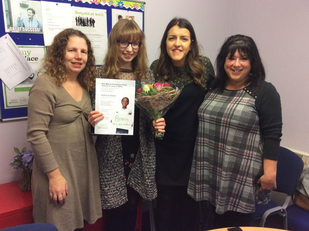 Rebekah with certificate standing with Barnardo's staff