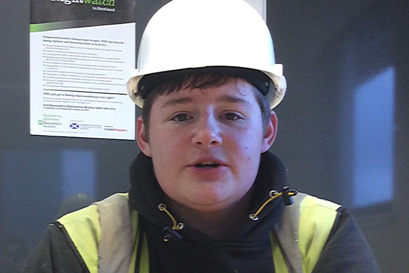 Apprentice Reece Hunter in a high visibility jacket and hard hat