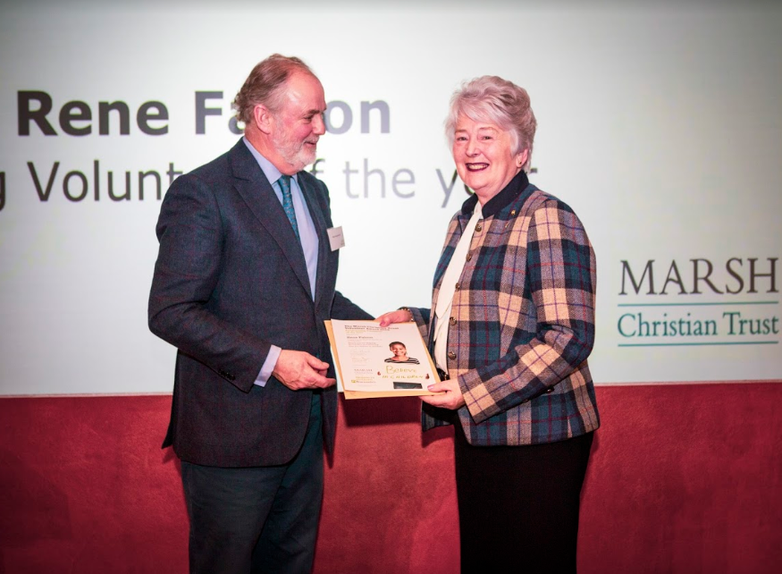 Rene Faloon receiving award