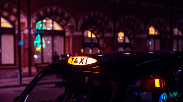 Image of a London taxi at night