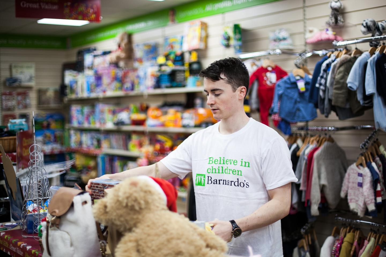 Barnardo's charity worker volunteering in a shop