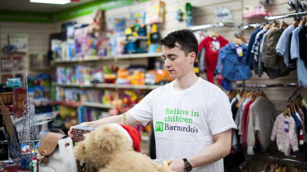 Barnardo's charity worker volunteering in a shop