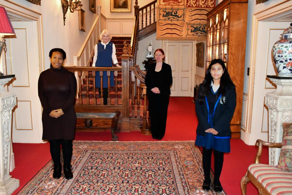 Two Barnardo's young carers at Clarence House with The Duchess of Cornwall