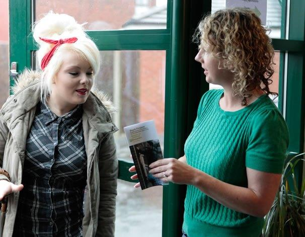 Barnardo's worker handing young person leaflet