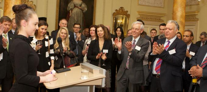 Philanthropists applauding at a fundraising dinner