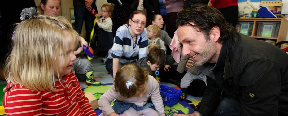 Philanthropist playing with children