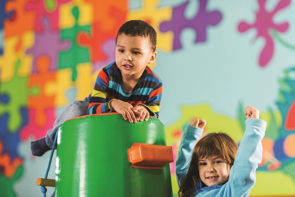 Young children playing in colourful children's centre environment