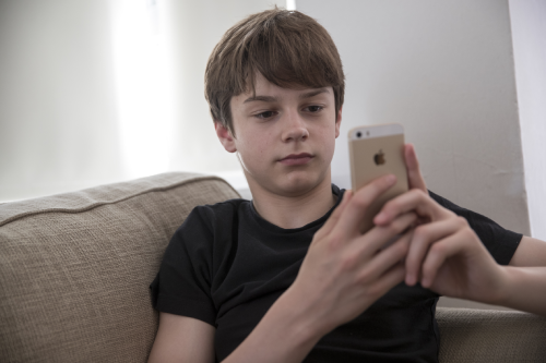 Young boy texting