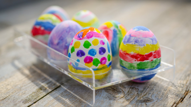 Colourfully painted easter eggs on a wooden table