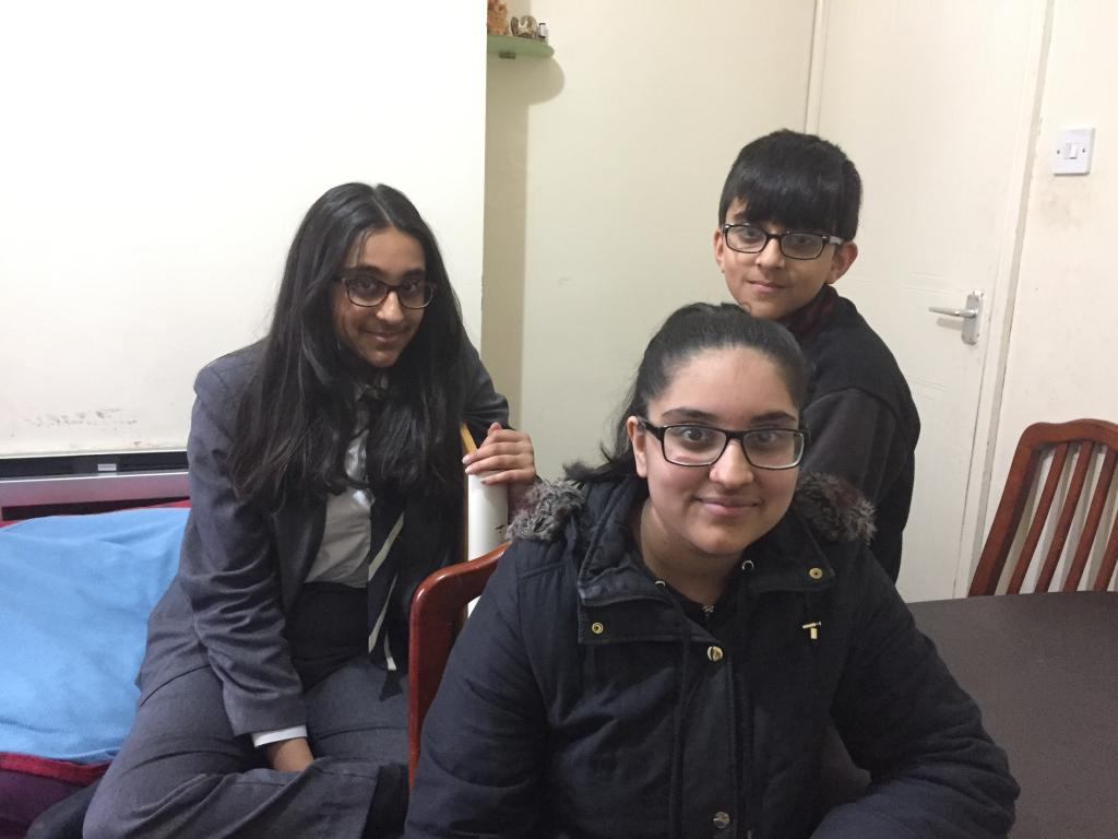 Three young carers sat at a table