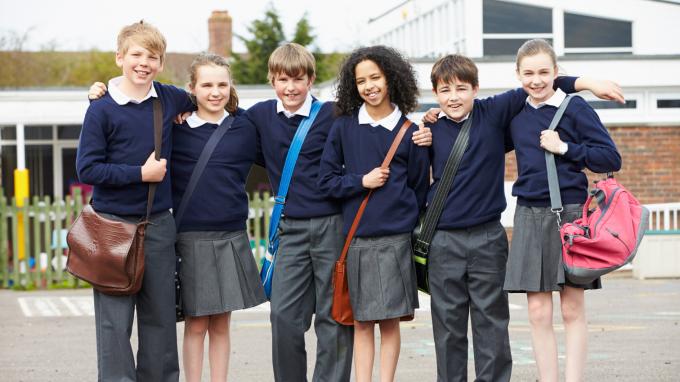 Group of school children standing in playground