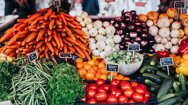 Assortment of colourful fruits and vegetables at a market stall
