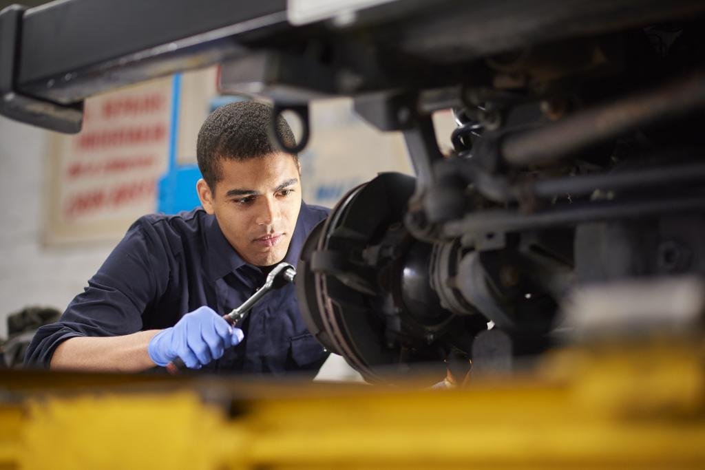 Young person working on mechanics