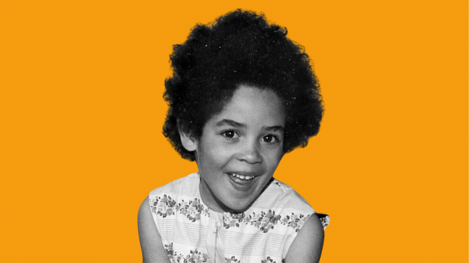 Old image of Julienne Wilding as a child, on orange background