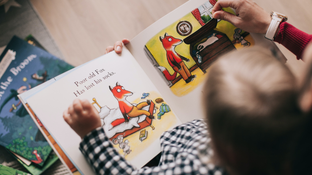 A child being read a book