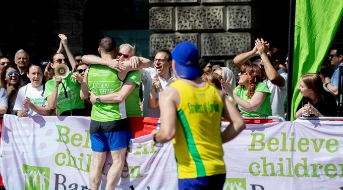 London Marathon runner hugging friend a cheer station