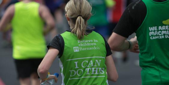 Marathon runner wearing a Barnardo's jersey