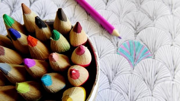 Coloured pencils and a colouring in book