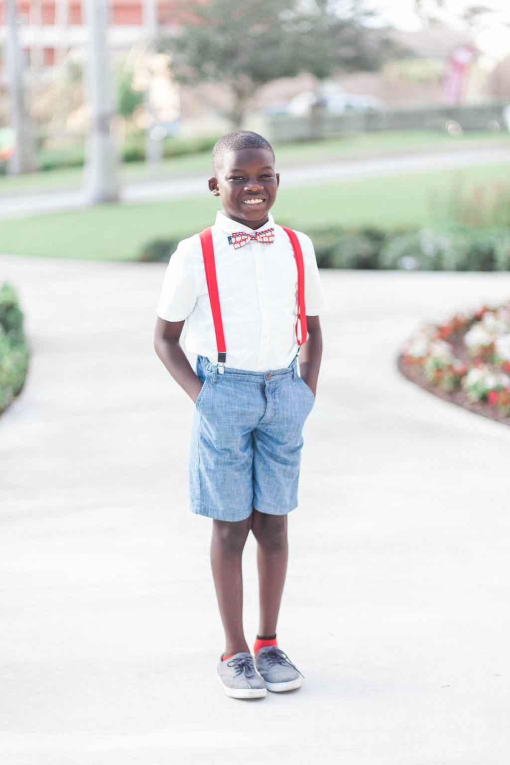 Young boy standing and smiling