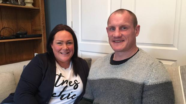 Foster carers Sarah and Richie at home